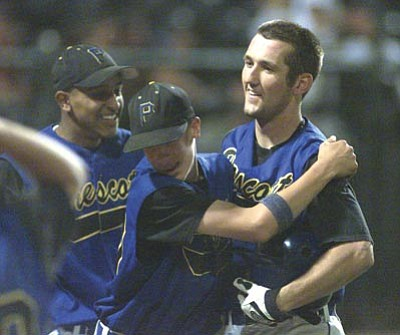 Photos by Les Stukenberg/The Daily Courier, file<br /><br /><!-- 1upcrlf2 -->Former Prescott High baseball player and current New York Mets outfielder Jason Pridie (right) celebrates with his teammates during a playoff game on May 15, 2002. The Badgers won the 2002 state championship.