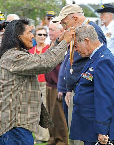 Matt Hinshaw/The Daily Courier<br> Fil Kewanyama, left, awards Dick Jonas an Air Force veteran the Medal of Valor along with 39 other U.S. Military veterans Thursday afternoon at the Veterans Island Park in Prescott.