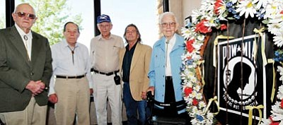 Les Stukenberg/The Daily Courier<br> Former POWs, from left, Daniel Roberts, WWII Bataan; Bob O'Neill, WWII OFlog 64 Poland; Wayne Daniels, WWII Satlag Luft 1; Walter Eckes, Vietnam escaped POW; and John Chance, WWII bomber crew, were the guests of honor at the 2011 POW/MIA Recognition Ceremony sponsored by the Northern Arizona VA Health Care System at the Prescott Resort Monday.