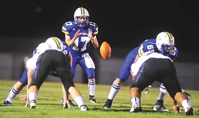 Les Stukenberg/The Daily Courier<br /><br /><!-- 1upcrlf2 -->Prescott High junior quarterback Nick Rock (17) takes a snap during his first start in the first half against Phoenix Moon Valley on Friday. Rock completed 4 of 9 passes for 57 yards and rushed for 49 yards on five carries.