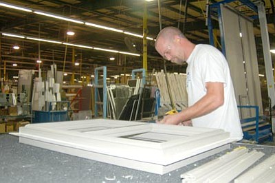 Jason Soifer/The Daily Courier<br>Doug Painter, line leader at MI Windows and Doors in Prescott Valley, assembles a new MI EnergyCore energy-efficient window.