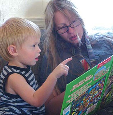First Things First/Courtesy<br>A Camp Verde mom, Kerrie, reads to her 2-year-old son Zayden during a home-based parenting program through First Things First called Parents as Teachers.