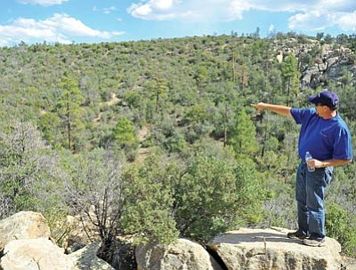 Matt Hinshaw/The Daily Courier<br> Acting City of Prescott Parks and Recreation Director Joe Baynes points out where a future trail will be built on the City of Prescott's new open space land Wednesday afternoon.