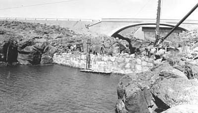 Sharlot Hall Museum/Courtesy photo<br>Workers build the dam at Sullivan Lake, the headwaters of the Verde River, in this 1934 photo.