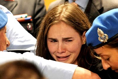 The Associated Press<br> Amanda Knox cries after hearing the verdict that overturns her conviction and acquits her of murdering her British roommate, Meredith Kercher, at the Perugia court, Italy, Monday.