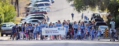 Les Stukenberg/The Daily Courier<br> Washington students and parents begin the Walk to School from Ken Lindley Field Tuesday morning.