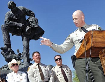 """Matt York/The Associated Press<br> Pinal County Sheriff Paul Babeu speaks as, from left, Cochise County Sheriff Larry Dever, Yavapai County Sheriff Scott Mascher, and LaPaz County Sheriff Don Lowrey listen during a press conference in front of the Arizona Peace Officers memorial Friday in Phoenix to discuss """"Operation Fast and Furious."""""""