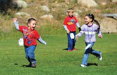 Les Stukenberg/The Daily Courier<br>Campers at Camp Runamuk play a game of tag as part of the gross-motor skills portion of the camp in Prescott Saturday morning. Families who attend the camp with support staff from the nonprofit Foundation for Exceptional Kids will take part in different therapies, presentations about how to handle behavior situations, find funding resources and take part in crafts, hiking, horseback riding and zip-lining.