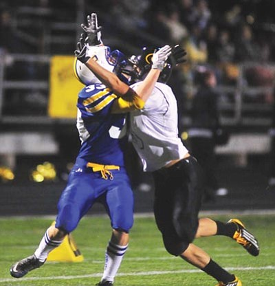 Les Stukenberg/The Daily Courier<br /><br /><!-- 1upcrlf2 -->Prescott receiver Reed Chiapetti gets interfered with as he attempts to catch a ball as the Badgers played Barry Goldwater last week in Prescott. PHS won 20-7.