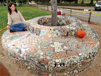 Les Stukenberg/The Daily Courier<br>Prescott College senior Kristin Anthony sits on the bench she built at Granite Creek Park.