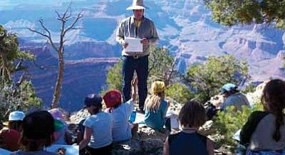 La Tierra Community School/Courtesy photo<br> La Tierra Community School teacher David McNelly leads a geology lesson for students at the rim of the Grand Canyon.