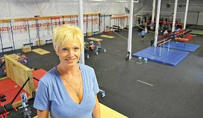 Matt Hinshaw/The Daily Courier<br>Lauren Jenai opened up the Captain CrossFit gym in Prescott in July. The 15,000-square-foot facility is the world's largest CrossFit gym.