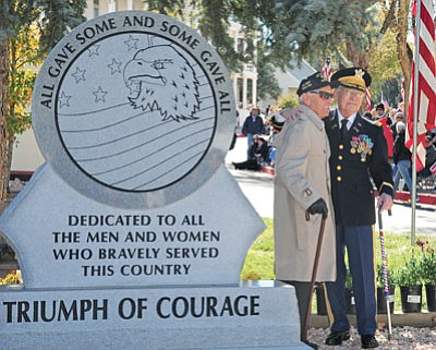 Brett Soldwedel/The Daily Courier<br>Wally Presmick, left, and Dr. John Tapia take in last year's Veterans Day Parade at the VA Medical Center. Presmick donated the money for the featured monument dedicated to service men and women.