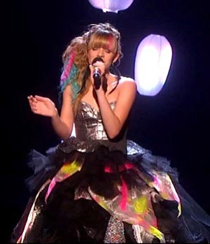 "Drew's dress inspired Simon Cowell to remark, ""You take risks. You have got the guts to design something yourself, which shows individuality (like) Lady Gaga."""