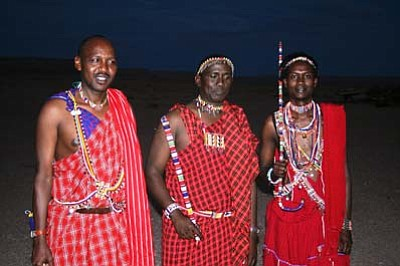 Left to right: Joshua Kiringal, Micheal Tiampati, John Kamanga. Project coordinator, South Rift Association of Land Owners of Nairbi, Kenya share stories and culture with local Navajo people. Submitted photo