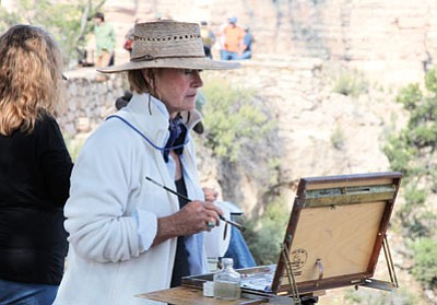 Linda Glover Gooch works on her quick draw painting along the South Rim of Grand Canyon during last years celebration of Art. Ryan Williams/WGCN