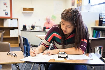 Corie Yazzie concentrates during a recent test in her AP calculus class taught by Brad Houston at Grand Canyon School. Students who pass the calculus AP test earn four credits that apply to first year of college. Ryan Williams/WGCN<br /><br /><!-- 1upcrlf2 -->