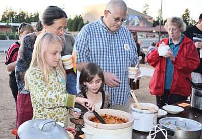 SuZan Pearce (left) and Ed Kennedy sample a variety of chili at  a past GC Rotary Chili Cook-Off. Photo/WGCN<br /><br /><!-- 1upcrlf2 -->