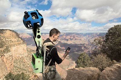 Luke Vincent, engineering director with Google Maps, treks down into the Grand Canyon with a camera tracker strapped to his back. Submitted photo<br /><br /><!-- 1upcrlf2 -->