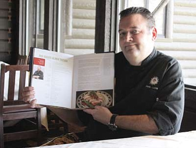 "Executive Chef Matt McTigue displays his Pan-Seared Salmon Tostada recipe in ""100 years 100 Chefs 100 recipes."" Clara Beard/WGCN"