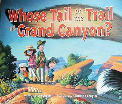 "Top: the ""Whose Tail..."" book cover. Bottom: author Midji Stephenson autographs ""Whose Tail on the Trail at Grand Canyon"" for a customer during the Dec. 6 Open House Holiday Event at Books and More in Grand Canyon National Park. Clara Beard/WGCN"