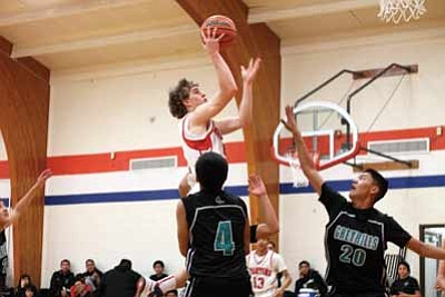 Junior swingman Ethan Berry elevates over his defenders for a two-pointer. Clara Beard/WGCN