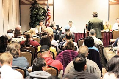A packed house listens as Grand Canyon Park Superintendent David Uberuaga addresses the Tusayan Town Council Oct. 26, 2011 regarding possible rezoning and development in the community neighboring Grand Canyon National Park. Clara Beard/WGCN
