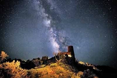 The Milky Way shines over Grand Canyon Watchtower at Desert View. Photo/Jeff Berkes Photography