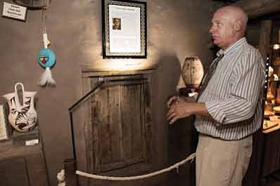 Xanterra's Henry Karpinski, Hopi House manager and historian of the region, explains the significance behind the Hopi Door. Karpinski was a key force behind the installation of the displays. Ryan Williams/WGCN<br /><br /><!-- 1upcrlf2 -->