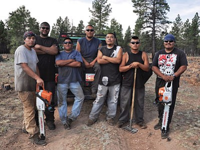 Members of the Alamo Navajo thinning crew from left to right:  Waylon Padilla, John Padilla, Tyrone Lee, Nigel Secatero, Filliam Herrera, Rodman Apache and Durvin Apachito. Dyan Bone, Kaibab National Forest