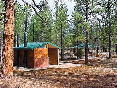 The bathroom and ramada at Ten-X Campground on the Tusayan Ranger District. Photo/ U.S. Forest Service, Southwestern Region, Kaibab National Forest.