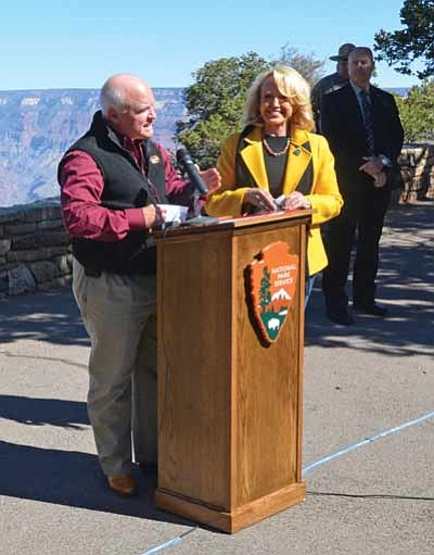 Governor Jan Brewer stands with Tusayan Mayor Greg Bryan during the park reopening Oct. 12. Mike Quinn/NPS