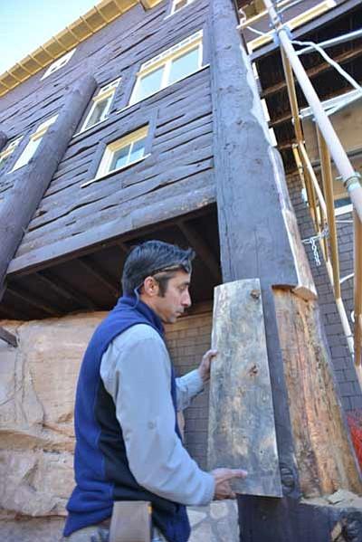 A crew member replaces a portion of Kolb Studio's beams. Photo/Terri Attridge