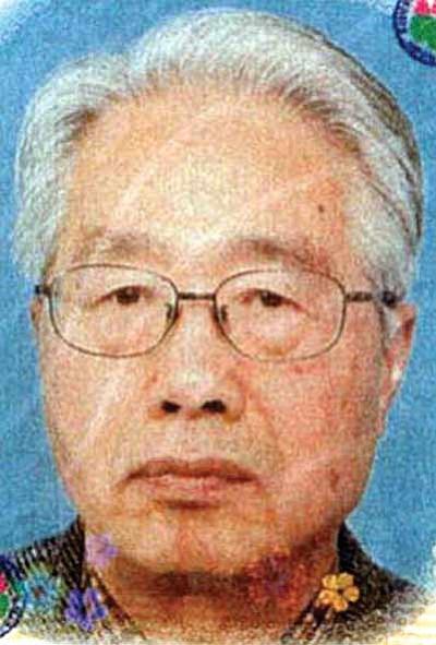Yoshikazu Yamada. Passport photo.