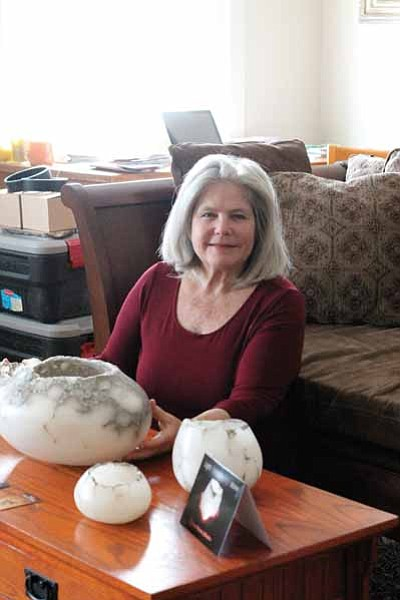 Susan Zalkind displays some of her alabaster candle bowls while staying at Verkamp's. Clara Beard/WGCN<br /><br /><!-- 1upcrlf2 -->