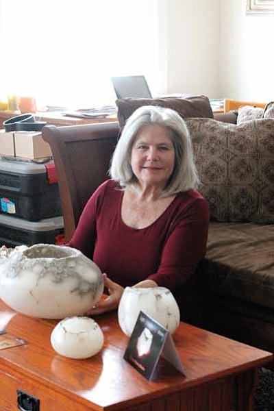 Susan Zalkind displays some of her alabaster candle bowls while staying at Verkamp's. Clara Beard/WGCN<br /><br /><!-- 1upcrlf2 -->
