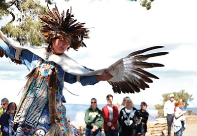 A Pollen Trail dancer performs an eagle dance for Grand Canyon visitors. In 2012, visitors spent $454 million in neighbouring communities in turn supporting 6,010 local jobs. Ryan Williams/WGCN<br /><br /><!-- 1upcrlf2 -->