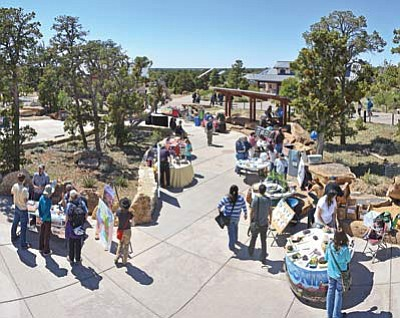 Visitors mingle around activity booths at a previous Earth Day.