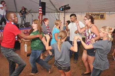 Revelers dance to live music in a recent Fourth of July celebration. Photo/WGCN