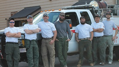 From Left: Donovan Hayes, Sean Ansted, Wesley Adams, G.C.N.P Fire Archeologist Jeremy Pribyl, Lukus Albin, Laren Nowell, and Aaron Mills take a break from digging fire lines around archeological sites on Sept. 25.  Loretta Yerian/WGCN