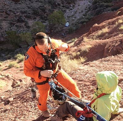 A search and rescue team member prepares an injured hiker who fell off the Clear Creek Trail in Grand Canyon for an airlift to safety. Photo/Coconino County Sheriff's Office