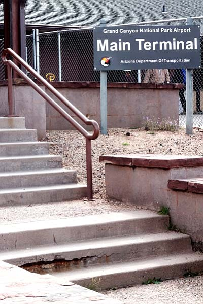 The entrance from the runway to the main terminal at Grand Canyon Airport shows signs of deterioration on the sidewalks and steps. Loretta Yerian/WGCN