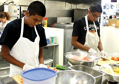 Culinary students Nick Gomez and Ben Ibara slice vegetables during class. Photos/Grand Canyon Yearbook Staff