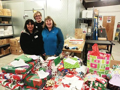 Local volunteers Grace Conklin, Alberta Saveedra & Goldie Pounds volunteer during last year's angel tree and community food basket program. Photo/ Carrie Putz.