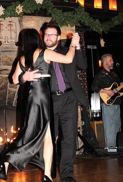Bentley Monk and Amala Posey take a spin on the dance floor during the annual dinner/dance Dec. 6. Loretta Yerian/WGCN
