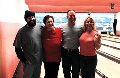Iron Turds team members Scott Amirault, Yvonne Trujillo, John Vail and Clarinda Vail at the bowling alley in Tusayan. Submitted photo