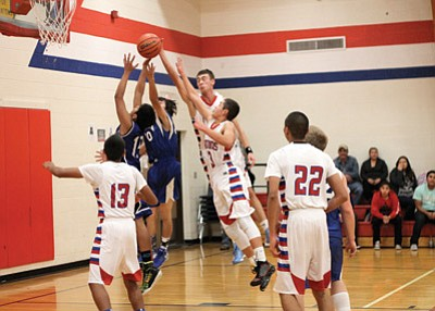 Grand Canyon Phantoms players fight for a rebound durng their Dec. 6 game against the Fredonia Lynx. Loretta Yerian/WGCN