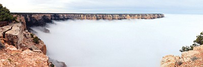 An uncommon sight, a total cloud inversion, obstructs the view of Yaki Point on the South Rim of Grand Canyon National Park Dec. 11. Photo/Michael Quinn