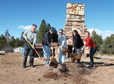 From left: Architect Michael Taylor, Red Feather Properties part owner Chris Thurston, Straightline Construction President Pete Muscarella, Red Feather Lodge General Manager Julie Aldaz and Red Feather part owner Clarinda Vail break ground on a housing project for Red Feather employees March 7. Ryan Williams/WGCN.