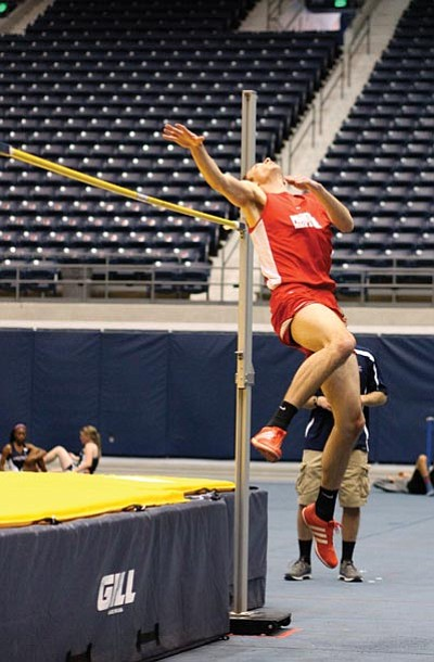 Tyler Jones springs from the NAU Skydome floor in Flagstaff for his high jump. Ryan Williams/WGCN